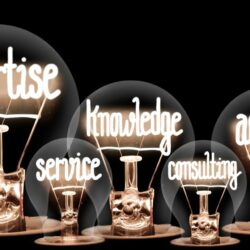 Group of light bulbs with shining fibers in a shape of Expertise, Teamwork, Advice, Knowledge and Research concept related words isolated on black background; horizontal composition